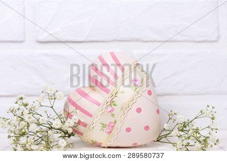 St. Valentine Day Background. Decorative Heart And White Flowers On White  Background Against White