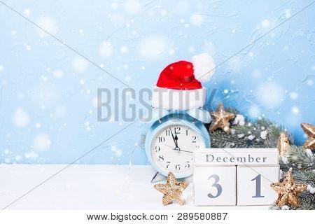 Calendar, Blue Alarm Clock,  Branches Fir Tree And Golden Stars On  Blue Textured  Background. Decor