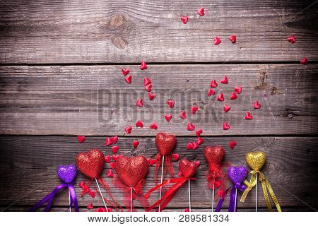 Border From Red, Violet And Gold Decorative  Hearts On Vintage Wooden Background. Selective Focus. P