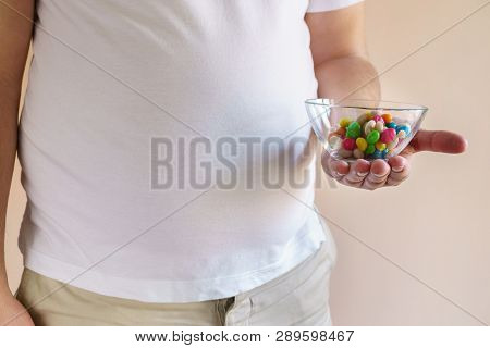 Fattening Food, High-calorie Snack. Weight Loss, Dietary, Balanced Nutrition. Overweight Man Eating