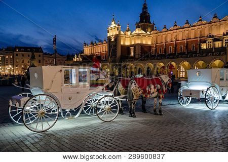Krakow, Poland - February 19: Horse Carriage At Main Square And The Cloth Hall On February 19, 2018