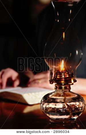 Reading By Vintage Oil Lamp