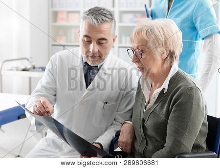 Radiologist Checking An X-ray Image With A Senior Patient