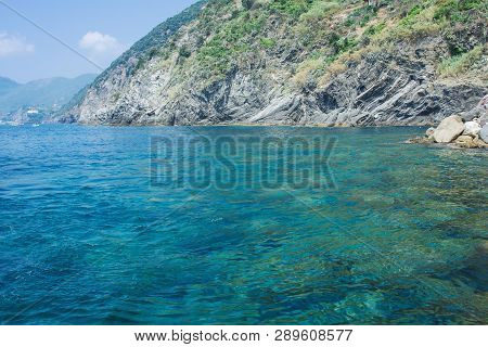 Sea, Sky, Coast And Mountains, Background With A Copy Space. Beautiful Seascape. Coast Of The Cinque