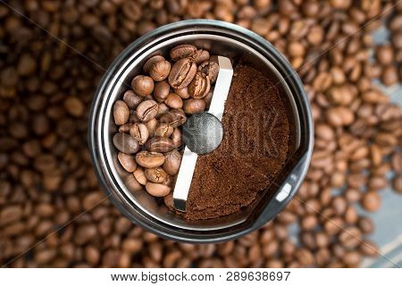 Coffee Grinder With Coffee Beans Isolated. In One Half Of Coffee Grinder Are Whole Grains Of Coffee,