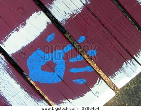 Blue Paint Hand On Red Picnic Table
