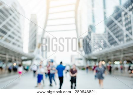 Many People Walking On The Skywalk With Blurry Image