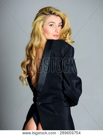 Woman sexy buttocks playful mood. Tempting horny woman with jacket wearing on naked body. Lady boss sex game. Feeling so sexy. Booty sexy fashion lady. Girl sexy blonde wear formal jacket backwards poster