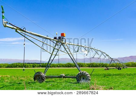Large Centre Pivot Irrigation System Running On A Farm In Canterbury, New Zealand. Long Movable Boom