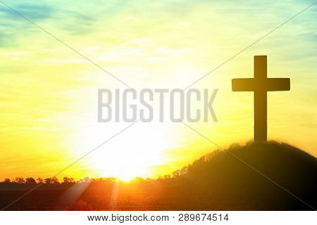 Silhouette Of Cross On Hill At Sunrise, Space For Text. Easter Holiday