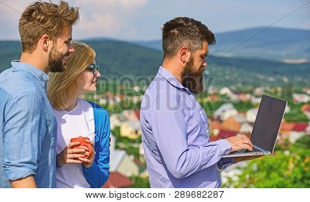 Colleagues With Laptop Work Outdoor Sunny Day, Nature Skyline Background. Business Partners Meeting