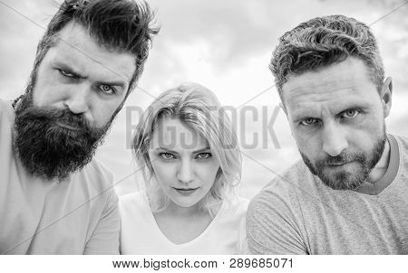 Suspicious Look. They Know What You Did. Threesome Suspiciously Look Down. Woman And Men Look Confid