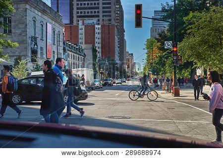 Montreal, Quebec, Canada, September 14, 2018: Pedestrians Are Crossing A Pedestrian Crossing, To A G
