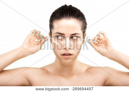Girl With Cotton Ear Sticks Making Grimace