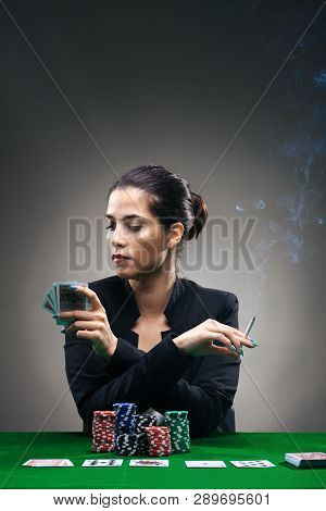 Poker Girl With Lot Of Chips And A Cigar