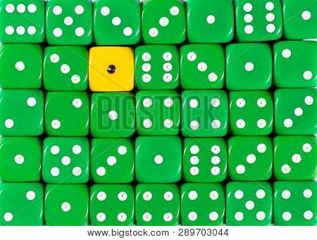 Pattern Background Of Random Ordered Green Dices With One Yellow Cube