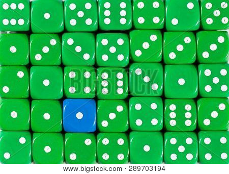 Pattern Background Of Random Ordered Green Dices With One Blue Cube