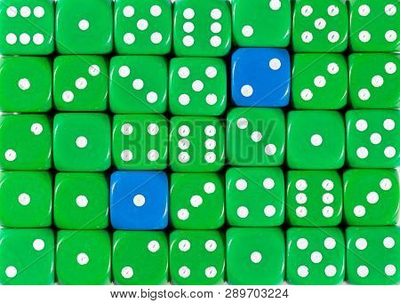 Pattern Background Of Random Ordered Green Dices With Two Blue Cubes