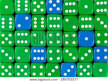 Pattern Background Of Random Ordered Green Dices With Six Blue Cubes