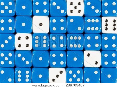 Pattern Background Of Random Ordered Blue Dices With Six White Cubes