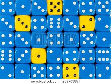 Pattern Background Of Random Ordered Blue Dices With Five Yellow Cubes