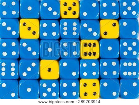 Pattern Background Of Random Ordered Blue Dices With Six Yellow Cubes