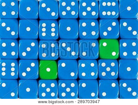 Pattern Background Of Random Ordered Blue Dices With Two Green Cubes