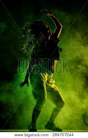 Silhouette Of A Girl Dancing, Smoke In The Background