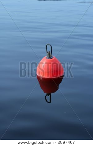 Plastic Buoy On The Blue Water