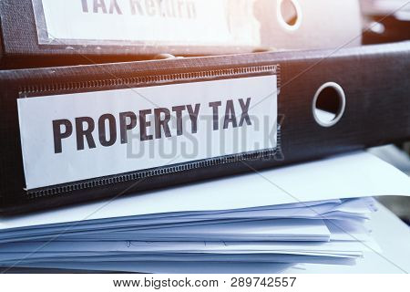 Property Tax And Tax Return Word On Folders Stack With Label Black Binder On Paperwork Documents Sum