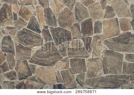 Light Brown Stone Wall Background. Light Brown Textural Background From Stone Mosaic. Light Brown St