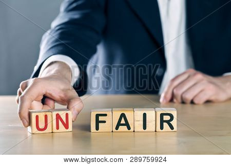 Business Man Puts Away First Two Letters From The Word Unfair, So It Becomes Fair; Sports Or Busines