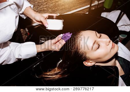 Beautiful Woman Washing Hair In A Hair Salon