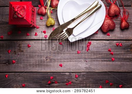 St. Valentine Day Table Setting.white Plates In Form Of Heart, Cutlery, Red And Golden Decorative He