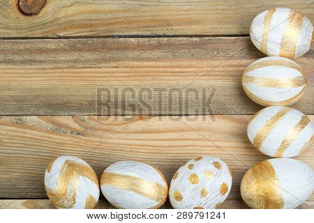 Happy Easter. Painted Eggs On Wooden Table. Top View.
