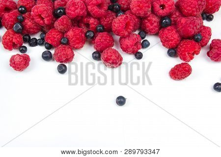 Various Fresh Summer Berries On A White Background. Top View