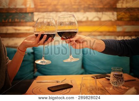 Restaurant, Couple, Celebration - Close Up Of Young Couple With Glasses Of Red Wine At Restaurant