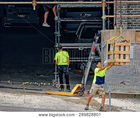 Gosford, New South Wales, Australia - January 31, 2019: Construction Workers On New Home Units Build