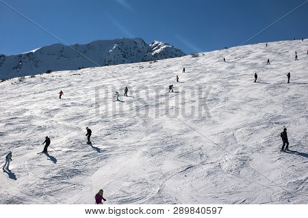 Lots Of Skiers And Snowboarders On A Slope At Sky Resort