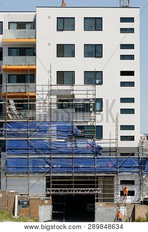 Gosford, New South Wales, Australia - March 4, 2019: Disassembling Scaffolding And Removing Safety N