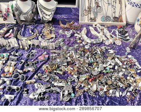 bijou on purple velvet tablecloth on flea market