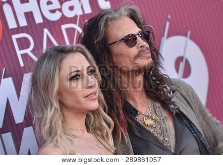 LOS ANGELES - MAR 14:  Steven Tyler and Aimee Preston arrives for the iHeart Radio Music Awards 2019 on March 14, 2019 in Los Angeles, CA