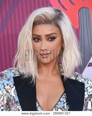 LOS ANGELES - MAR 14:  Shay Mitchell arrives for the iHeart Radio Music Awards 2019 on March 14, 2019 in Los Angeles, CA