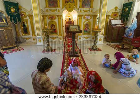 KOH CHANG, THAILAND - MAR 4, 2018: During the Sunday service in Russian Orthodox Church. There are currently 10 Orthodox parishes in Thailand, Orthodoxy is practiced by 0.002% of population.