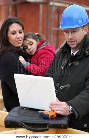Architect on location with a young family