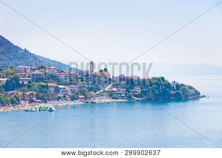 Gradac, Dalmatia, Croatia, Europe - August 24, 2017 - Aerial View Upon Bathing People At The Bay Of