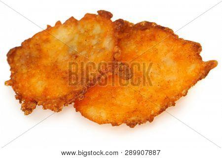 Crunchy keto cheese crisp over white.