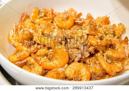 A Shrimp With Garlic In White Dish