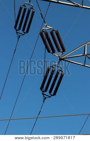Power Line Insulators On A Blue Sky In Daylight