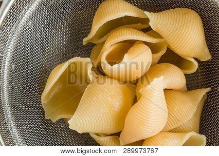 Conchiglioni Pasta, Big Shells On Metal Sieve, Top View